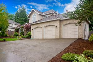 Wide driveway provides easy access to 3-car garage