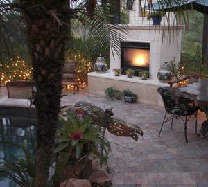 Fireplace as the focal point for an elegant outdoor patio