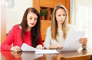 Two women reviewing paperwork