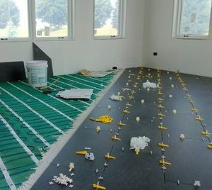 Installation of floor heating and flooring shown side by side