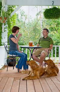 Family relaxing and enjoying quality time on their porch with some iced tea