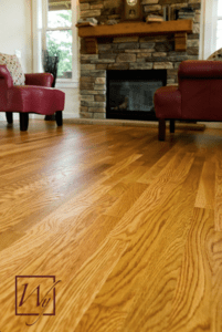 Heated hardwood floors in a living room are a great upgrade.