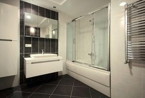 Bathroom transformed with the addition of a towel rack and mirror defogger