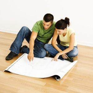 Couple reviewing their remodeling blueprints