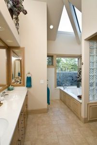 Adequate ventilation, radiant floor heating, and towel warmers can reduce bathroom humidity that promotes mold and mildew growth.
