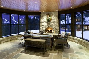 Custom fireplace room with stone flooring
