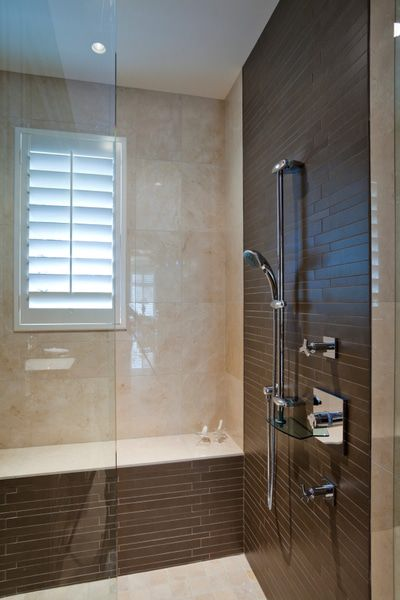 Shower floors and benches can be heated with electric radiant heat.